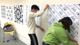 Ethan Wong and Jiyoo Suh put up tile prints
